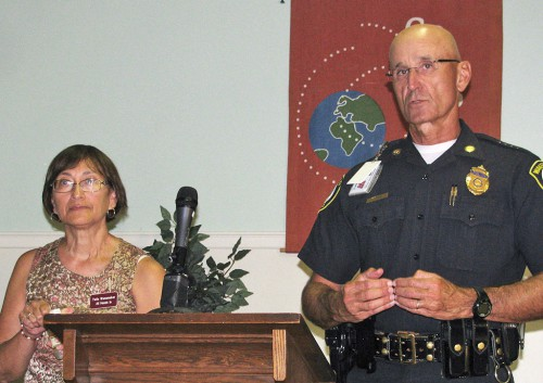 """TWILA WANAMAKER of """"All Hands In"""" and Police Chief Rick Smith spoke last night at the First Baptist Church forum on human trafficking and prostitution. (Mark Sardella Photo)"""