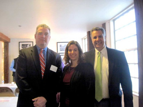 TOWN ADMINISTRATORS James Boudreau (Lynnfield, at left) and Stephen P. Maio (Wakefield, at right) spoke about the business climate in their respective towns at a Wakefield-Lynnfield Chamber of Commerce breakfast meeting held at The Meeting House in Lynnfield. Boudreau and Maio are shown with Chamber Executive Director Marianne Cohen. (Gail Lowe Photo)